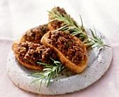 Crostini con trito di coniglio (Crostini with minced rabbit)