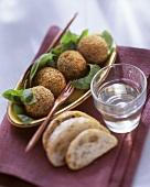 Deep-fried fish balls on basil