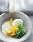 Poached peaches with sambuca whip and vanilla ice cream