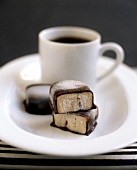 A cup of coffee with pralines