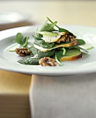 Spinach salad with smoked cheese and walnuts