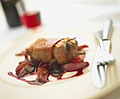 Beef fillet with Parma ham and onions on red wine sauce