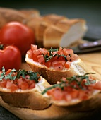 Baguette with diced tomatoes and basil