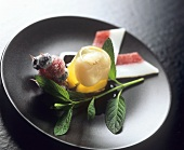 Lychee in jelly garnished with sugared fruit on cocktail sticks
