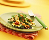 Shrimp salad with spring onions on eggs