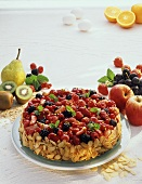 Fruity berry gateau with flaked almonds