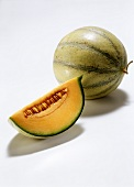 A whole Charentais melon and melon slice