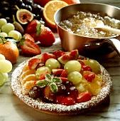 A fruit tart, pan with gelatine behind
