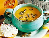 Cold cream of pumpkin soup, with toast and herb quark