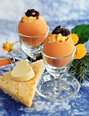 Scrambled egg with caviare in egg shell, with buttered toast