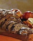 Fruit bread, a slice cut; apple, pear and dried fruit