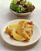 Fish fillets in beer batter with mixed salad (Switzerland)