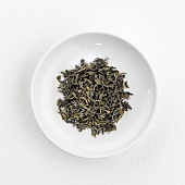 Green tea leaves (Gu Zhang, China) on plate
