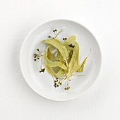 Lime blossom tea (dry) on plate