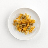 Dried marigolds (for marigold tea) on plate