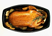 Stuffed goose in black roasting dish