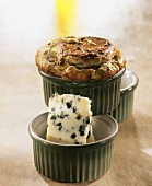 Roquefort and walnut soufflé in green baking dish