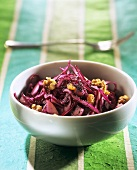 Red cabbage salad with raisins, poppy seeds and walnuts