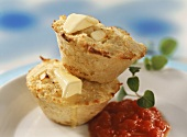 Savoury potato & cheese muffins with butter and tomato sauce