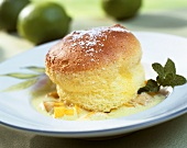 Lime soufflé on fruit ragout with woodruff whip