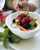 Berry salad with custard and lemon balm