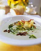 Leek and potato soup with bacon and herbs