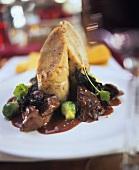 Braised venison with black chanterelles & napkin dumpling