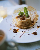 Bread pudding with raisins and elderberry sauce