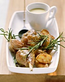 Baked guinea-fowl legs with rosemary potatoes
