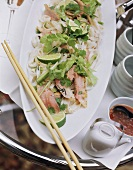 Rice noodle salad with duck breast and limes for brunch