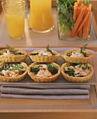 Shrimp quiches for fitness brunch; raw vegetables; fruit juice