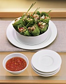 Filled lettuce rolls with chili sauce for fitness brunch