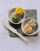 Various spicy goat's cheese balls in small bowls