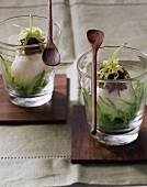 Eggs in glasses with ginger and strips of mangetout