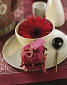Asian place setting with red flower and place-card