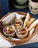 Baked egg tapas with capers and tomatoes; white bread