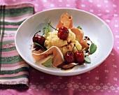 Polenta with cherries and raw ham