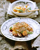 Zander with nut crust on autumn vegetables with red wine