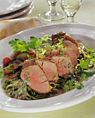 Pork fillet with herb and mustard sauce on ribbon pasta