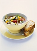 Vegetable soup with courgettes, peppers and cherry tomatoes