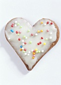 Heart-shaped biscuits with glace icing and 100s and 1000s