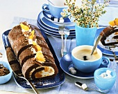 Chocolate and mandarin roulade, black coffee and sugar cubes