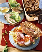 Spelt bread with trout fillet; bagel with turkey ham and egg