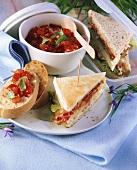 Club sandwich with chicken and ciabatta with tomato salsa