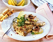 Swordfish steaks with anchovy butter and pink pepper