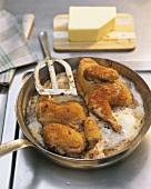 Frying breaded poussin in butter