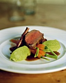 Venison fillet with cinnamon, carrots & herb polenta dumplings