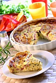 Quiche with ham in baking dish and on plate