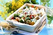 Greek salad with potatoes and yoghurt sauce