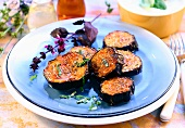 Spicy fried aubergine slices with herbs